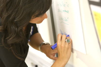 What's Next Marin Woman Writing on Whiteboard